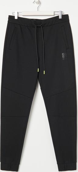 Czarne spodnie sportowe Sinsay w sportowym stylu z dresówki