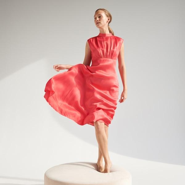 Pomarańczowa sukienka Reserved z satyny