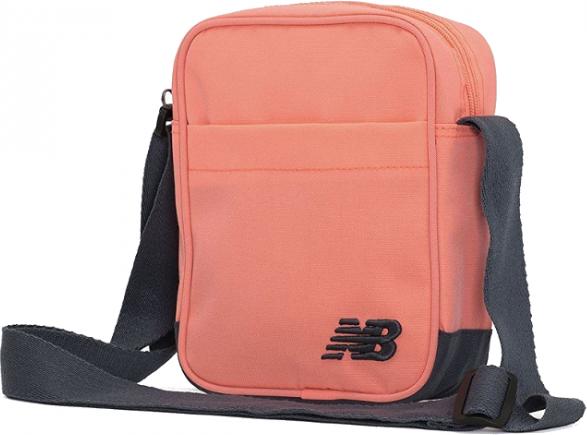 10a8028494e16 Pomarańczowa torebka New Balance w sportowym stylu średnia na ramię