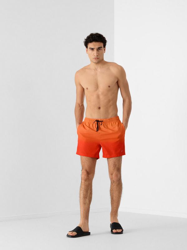 Pomarańczowe kąpielówki 4F