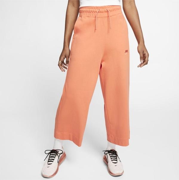 Pomarańczowe spodnie Nike z dżerseju