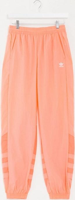 Pomarańczowe spodnie sportowe Adidas Originals w sportowym stylu