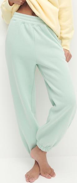 Turkusowe spodnie Reserved z dzianiny