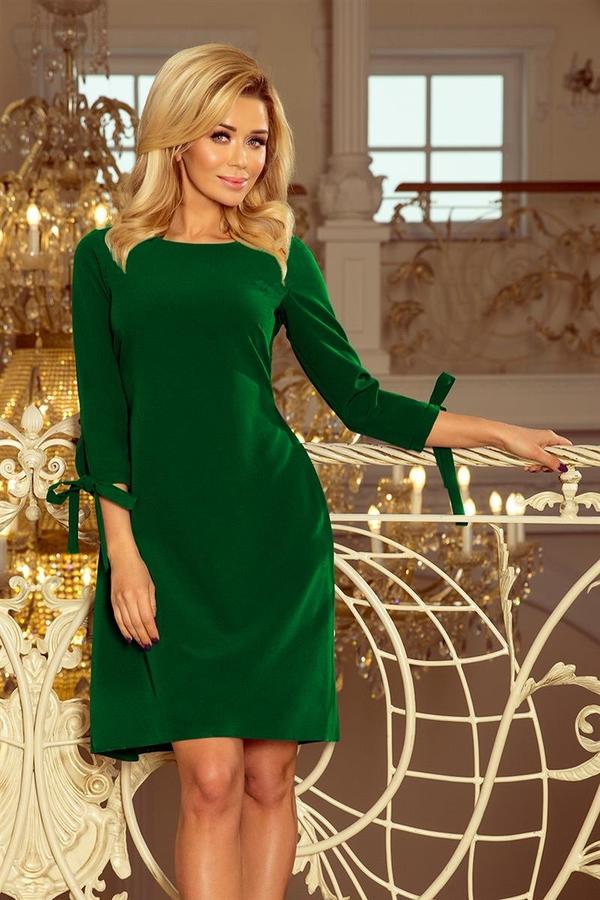 cf1fc99e55 Zielona sukienka NUMOCO trapezowa midi z długim rękawem