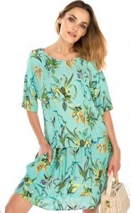 Zielona sukienka L'AF z jedwabiu rozkloszowana