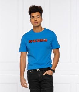 Niebieski t-shirt Guess w młodzieżowym stylu z krótkim rękawem