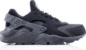 Niebieskie buty sportowe Nike huarache w sportowym stylu