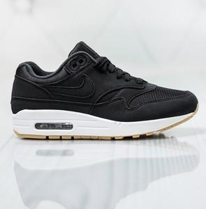 Czarne buty sportowe Nike z płaską podeszwą sznurowane