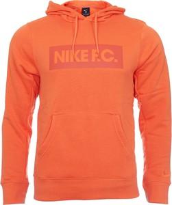 Pomarańczowa bluza Nike w sportowym stylu