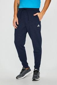 Granatowe spodnie sportowe Adidas Performance z bawełny