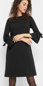 Czarna sukienka ORSAY z długim rękawem w stylu casual z okrągłym dekoltem