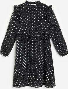 Czarna sukienka dziewczęca Reserved w groszki