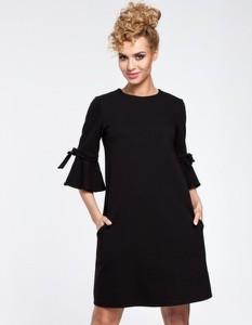 Czarna sukienka MOE z długim rękawem trapezowa