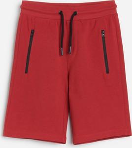 Czerwone spodnie dziecięce Reserved dla chłopców