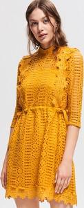 Żółta sukienka Reserved z golfem