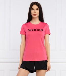 Różowa bluzka Calvin Klein z okrągłym dekoltem z krótkim rękawem w młodzieżowym stylu