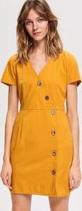 Żółta sukienka Reserved z bawełny