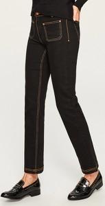 Czarne jeansy Reserved w młodzieżowym stylu