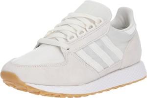 Buty sportowe Adidas Originals w młodzieżowym stylu z płaską podeszwą