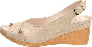 Złote sandały Suzana z klamrami na średnim obcasie