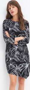 Czarna sukienka Mohito mini z długim rękawem asymetryczna
