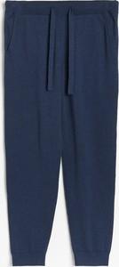 Granatowe spodnie Reserved z dresówki
