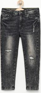 Czarne jeansy dziecięce Reserved z jeansu