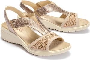 Złote sandały Imac na koturnie ze skóry