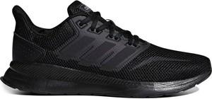 Buty sportowe Adidas na koturnie w sportowym stylu