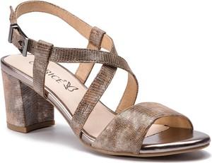Sandały Caprice ze skóry na słupku z klamrami