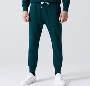 Zielone spodnie sportowe Cropp