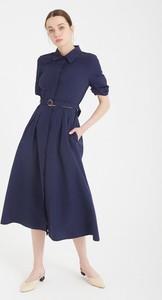 Granatowa sukienka BGN z długim rękawem