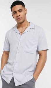 Niebieska koszula topman z krótkim rękawem z klasycznym kołnierzykiem