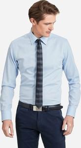 Błękitna koszula wólczanka