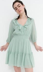 Zielona sukienka House z tkaniny z dekoltem w kształcie litery v