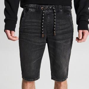 Fioletowe spodenki Cropp z jeansu