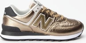 Złote buty sportowe New Balance sznurowane
