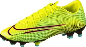 Żółte buty sportowe Nike sznurowane w sportowym stylu