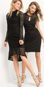 Czarna sukienka ORSAY z dekoltem w kształcie litery v midi asymetryczna