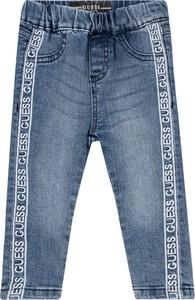 Niebieskie jeansy dziecięce Guess