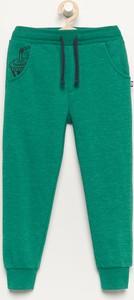 Turkusowe spodnie dziecięce Reserved