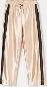 Złote spodnie dziecięce Reserved