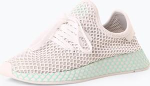 Różowe trampki Adidas Originals w młodzieżowym stylu na koturnie sznurowane
