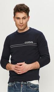 Czarny sweter Guess z dzianiny w młodzieżowym stylu