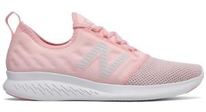Różowe buty sportowe New Balance sznurowane z płaską podeszwą