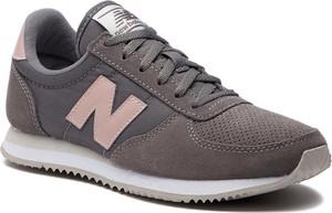 Brązowe buty sportowe New Balance z płaską podeszwą w stylu casual ze skóry