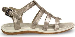 Złote sandały Geox w stylu casual z klamrami z płaską podeszwą
