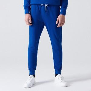 Niebieskie spodnie sportowe Cropp z dresówki