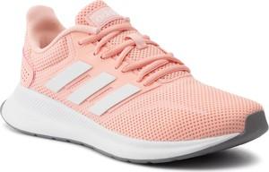 Różowe buty sportowe Adidas sznurowane z płaską podeszwą