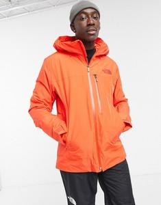 Pomarańczowa kurtka The North Face z plaru w sportowym stylu